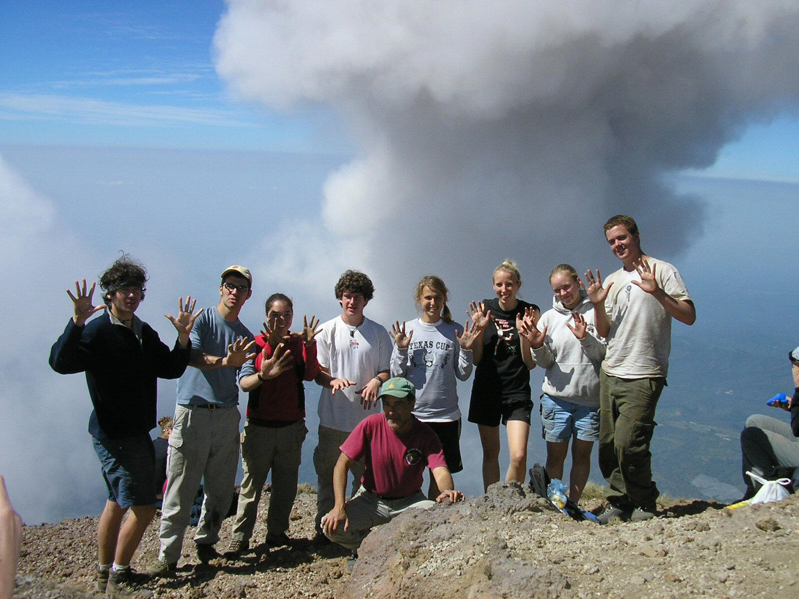 High School students celebrating with the Guatemalensis Spanish School staff at the summit of the Santa Maria volcano.
